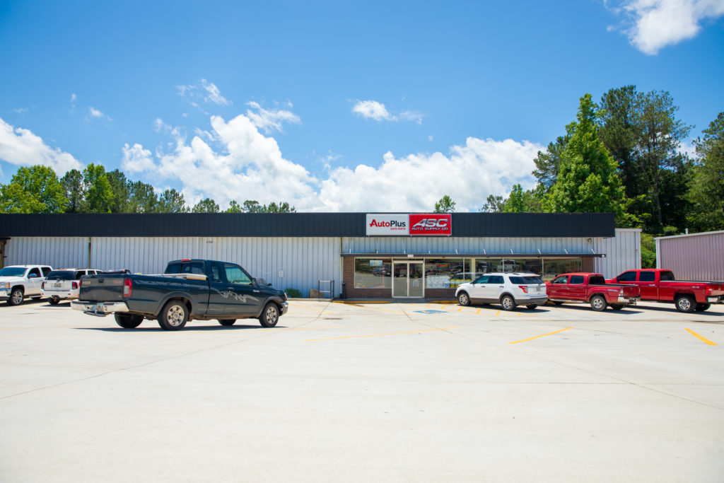 panoramic view of the outside of the auto supply company store
